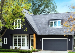 House painted in dark blue with white trim and natural oak color on an accent column at the entrance, Exterior painting, Residential painting exterior painting contractor